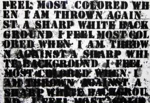 "Detail from Glenn Ligon's ""Untitled [I Feel Most Colored When I Am Thrown Against a Sharp White Background]""."