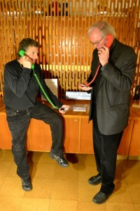 Peter Payack and Roland Pease listen to audio files from the Phone-a-Poem archive in the Woodberry Poetry Room.